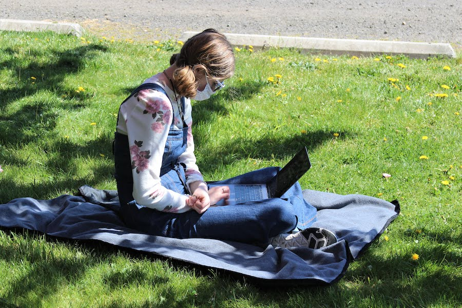 WSA student studying outside on a sunny spring day