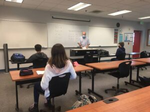 Lionel Pummell teaching math to middle school students